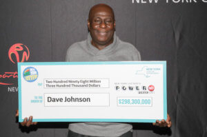 David Johnson from New York with his Powerball jackpot check