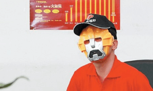 China costumed lottery winner robot mask